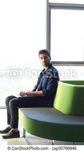 student working on laptop - csp30766946