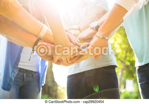Students hands together - csp29920454