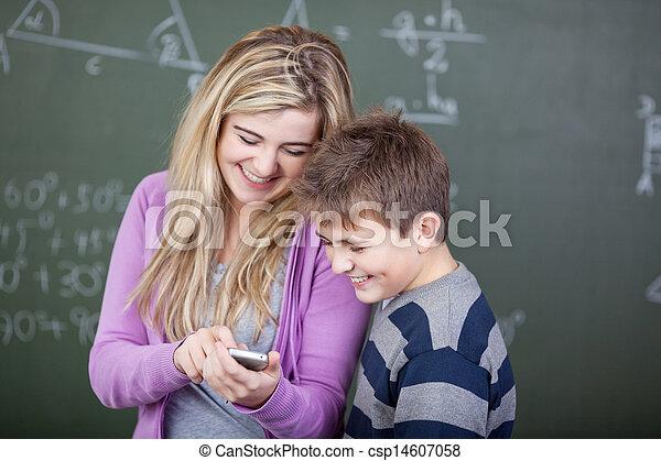 Students sharing a joke - csp14607058