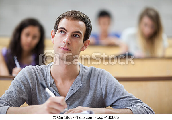 Students taking notes in an amphitheater - csp7430805