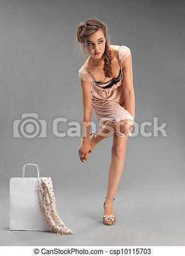 studio, fashion portrait, young woman shopping - csp10115703