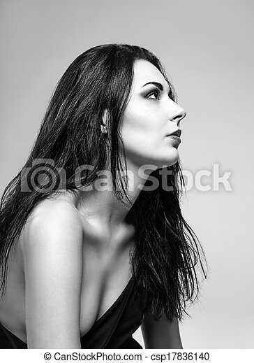 Studio portrait of a beautiful girl profile view black and white photo