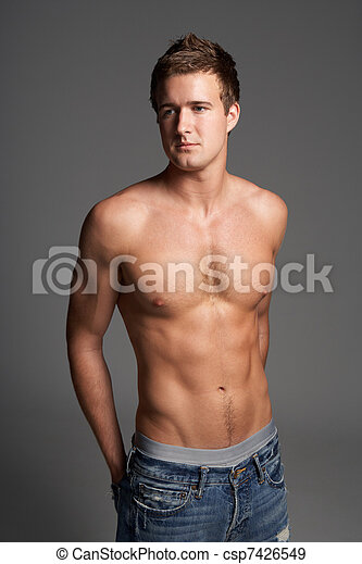 Studio Portrait Of Bare Chested Muscular Young Man - csp7426549