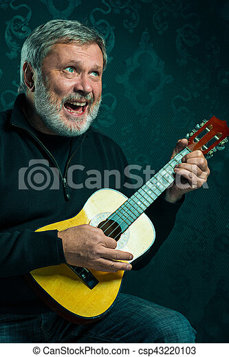Studio portrait of senior man with guitar. - csp43220103