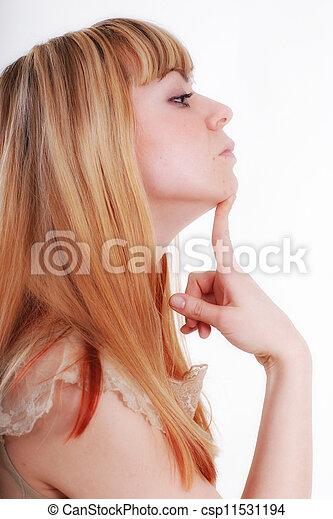 Studio portrait of young pensive woman in profile - csp11531194
