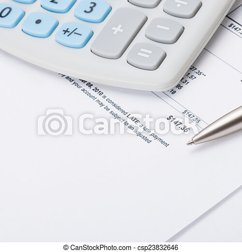 Studio shot of calculator and pen over some receipt - accounting concept - csp23832646