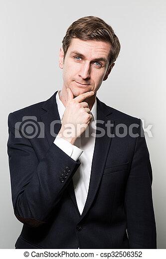Studio Shot Of Thoughtful Businessman