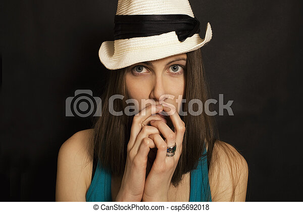 Studio shoulder portrait of young blue-eyed girl in white hat - csp5692018