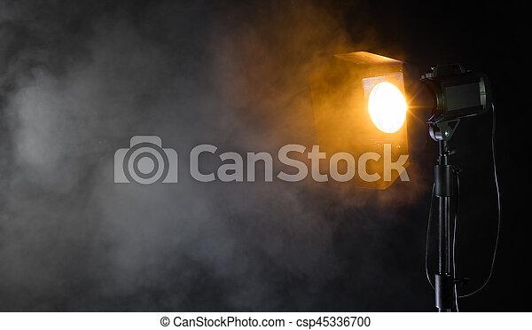 Studio spot light with smoke effect - csp45336700