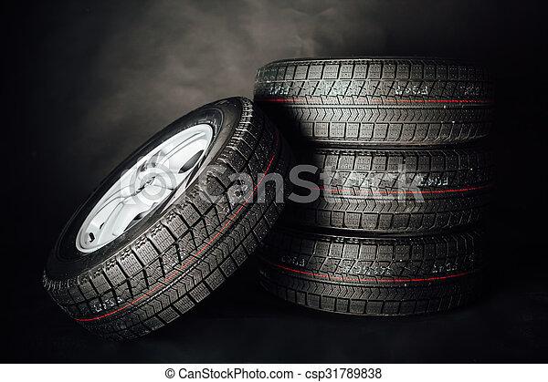 studless winter tires, black background - csp31789838