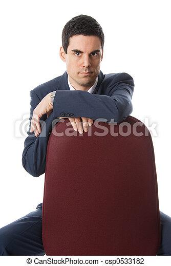 Mann auf einem Stuhl - csp0533182
