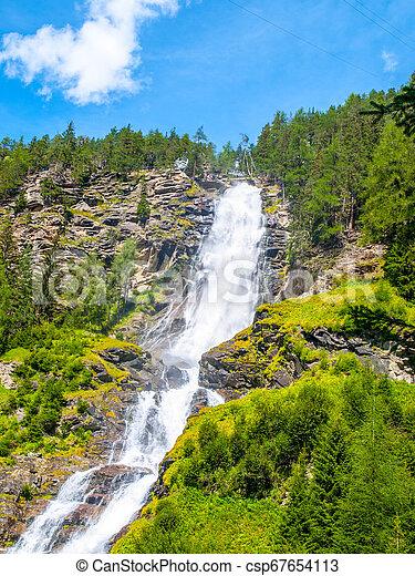 Stuiben waterfall, or Stuibenfall, is the highest waterfall in Tyrol, Austria. View from below - csp67654113