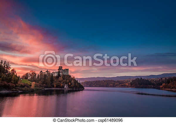 Stunning dusk over castle by the lake, Poland - csp61489096