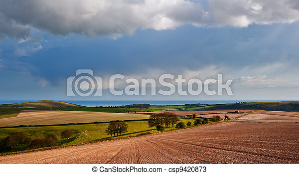 Stunning landscape with stormy sky over rural hills - csp9420873