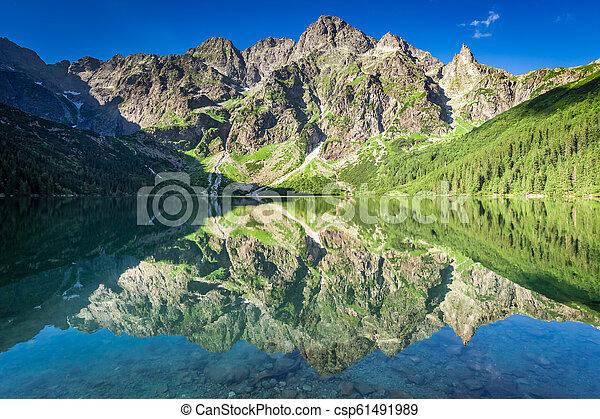 Stunning sunrise at lake in the Tatra Mountains, Poland - csp61491989