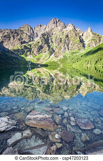 Stunning sunrise at lake in the Tatra Mountains, Poland, Europe - csp47203123