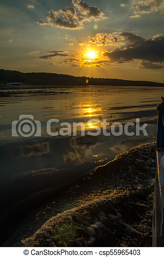 Stunning sunset colors reflected in the river - csp55965403