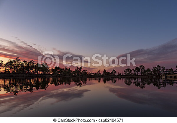 stunningly beautiful view of the evening sky over a forest lake - csp82404571