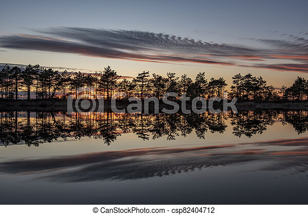stunningly beautiful view of the evening sky over a forest lake - csp82404712