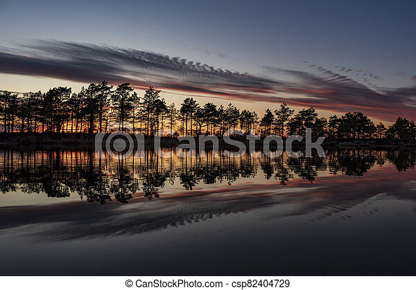 stunningly beautiful view of the evening sky over a forest lake - csp82404729