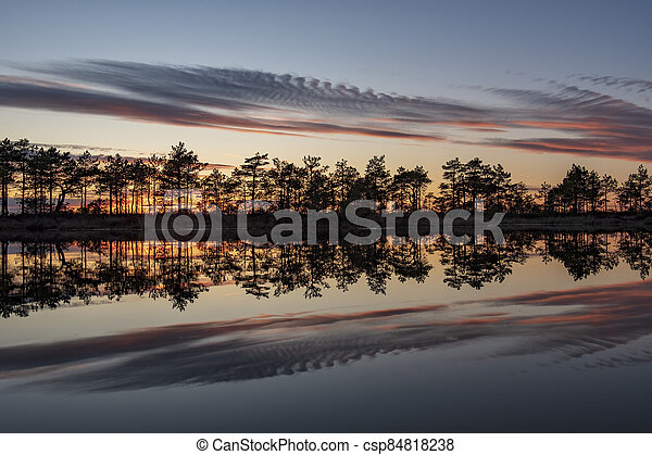 stunningly beautiful view of the evening sky over a forest lake - csp84818238