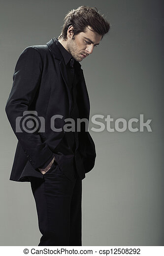 Stylish and handsome businessman in natural pose - csp12508292