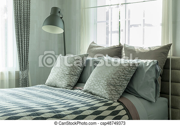 Stylish Bedroom Interior Design With Patterned Pillows On Bed And Decorative Table Lamp Canstock