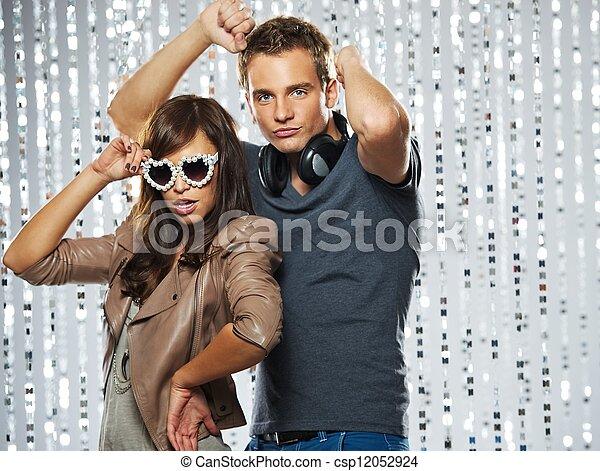 Stylish couple dancing in the nightclub - csp12052924