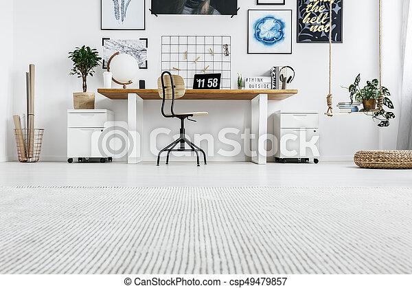 Stylish furniture in modern home office for designer
