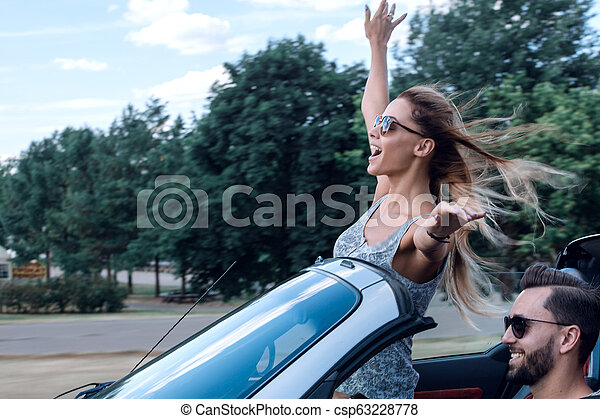 stylish girl enjoying a ride in a convertible car