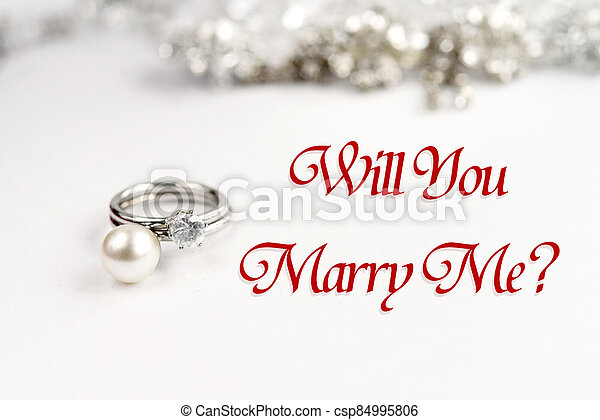 stylish luxury rings, will you marry me text, greeting card concept - csp84995806