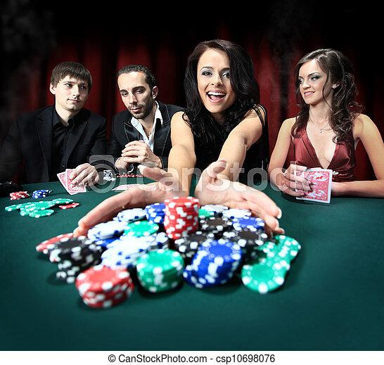 Stylish woman wins in the casino - csp10698076