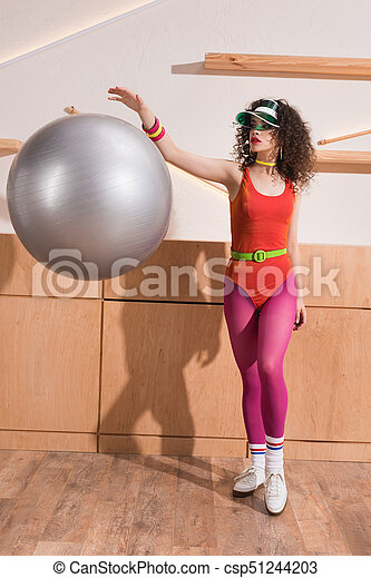 stylish woman with fitness ball - csp51244203