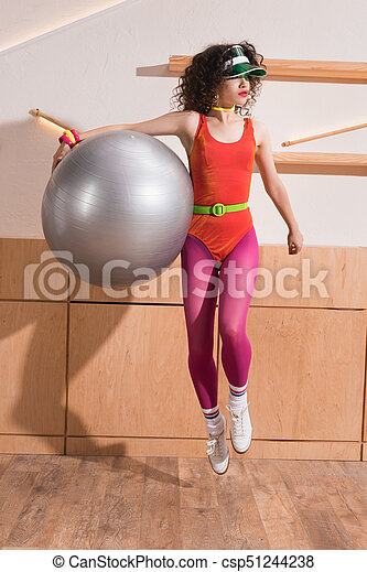 stylish woman with fitness ball - csp51244238