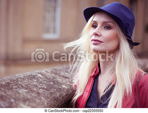 Stylish Young Blond Woman Waiting Outdoors