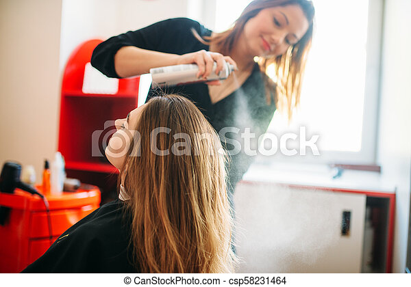 Stylist is preparing to apply mousse, hairdressing - csp58231464