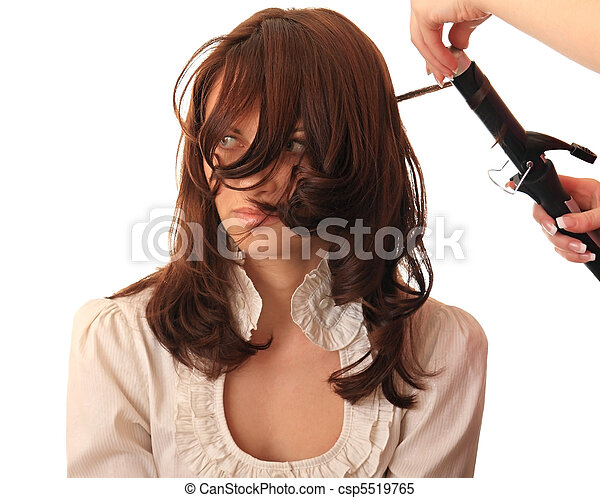Stylist makes hair beautiful girl. - csp5519765