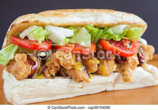 Submarine sandwich fried chicken closeup - csp39154095
