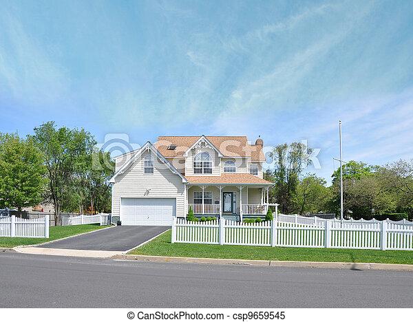 Suburban Home White Picket Fence - csp9659545