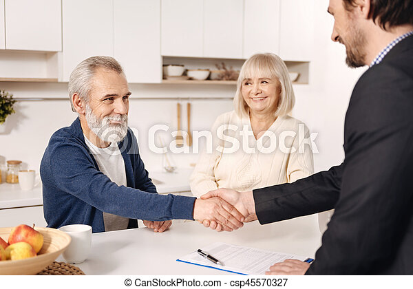 Successful broker meeting with elderly couple of clients - csp45570327
