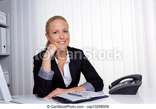successful business woman in office - csp10298009