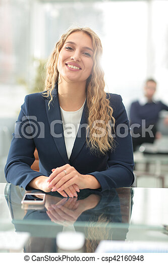 Successful business woman with her staff in background at office - csp42160948