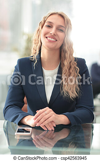 Successful business woman with her staff in background at office - csp42563945