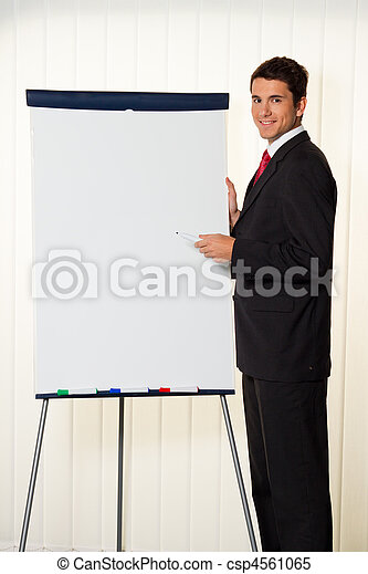 Successful businessman with a flipchart for presentation - csp4561065