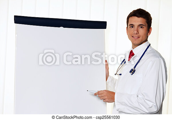 successful doctor with a flip chart - csp25561030