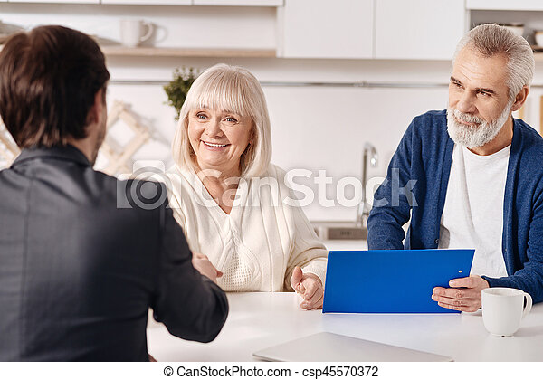 Successful lawyer working with aged couple in the house - csp45570372