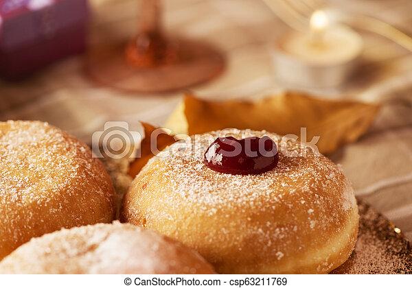 sufganiyot, Jewish donuts eaten on Hanukkah - csp63211769
