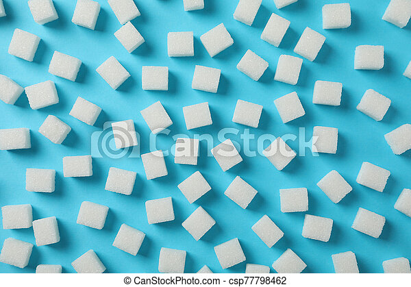 Sugar cubes on blue background, top view - csp77798462