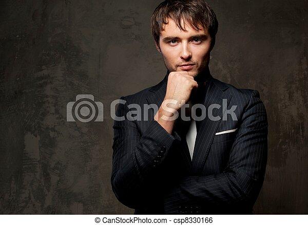Hermoso joven con traje. - csp8330166