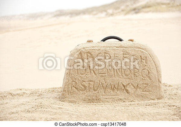 Suitcase made out of sand with alphabet - csp13417048